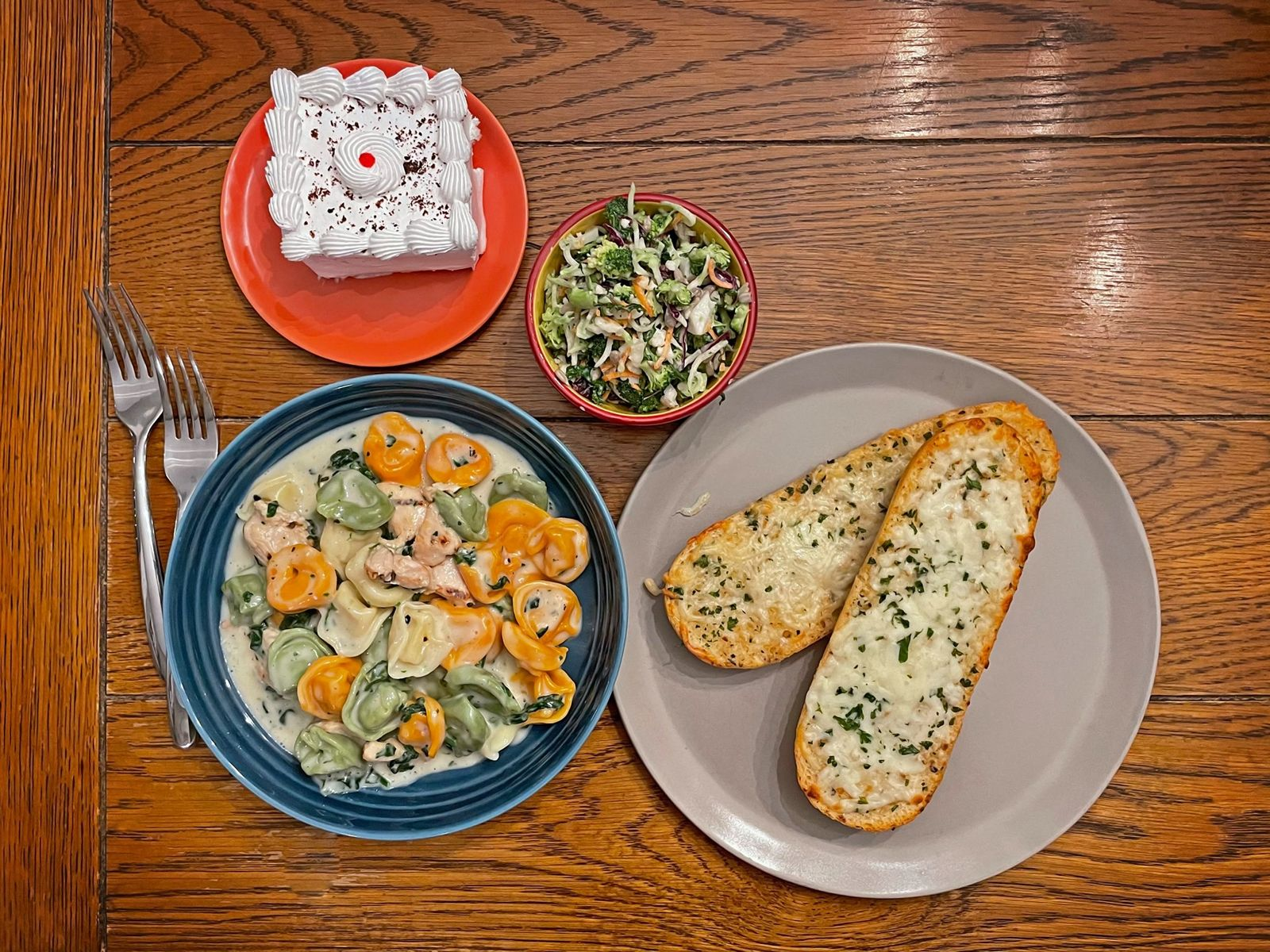 Each Bavarian Boxed Bundle meal includes an entrée, side, baked good and dessert. Pictured here is the restaurant's delicious cheese tortellini and spinach alfredo with grilled chicken, garlic bread, broccoli crunch salad and torte.